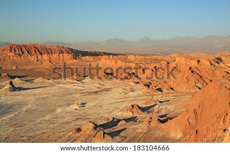 Sunset at Valley of the Moon, San Pedro de Atacama, Chile  El Valle de la Luna is located in Atacama desert of Chile. It has various stone and sand formations which have been carved by wind and water. - stock photo