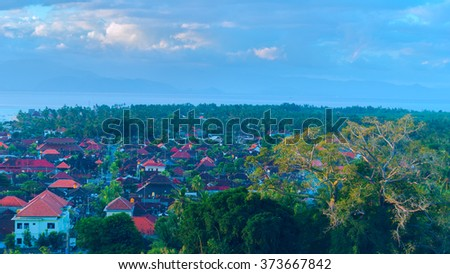 Sunset at village on island Lombongan near Bali - stock photo