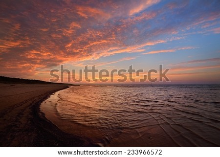 Sunset Baltic sea shore in Latvia with at the pink sunset - stock photo