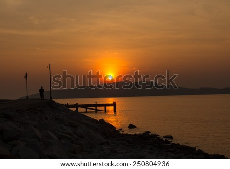 sunset Beach, near the point of view of the bridge. - stock photo