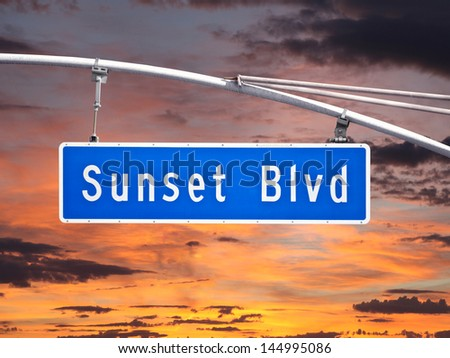 Sunset Blvd overhead street sign with sunset sky. - stock photo