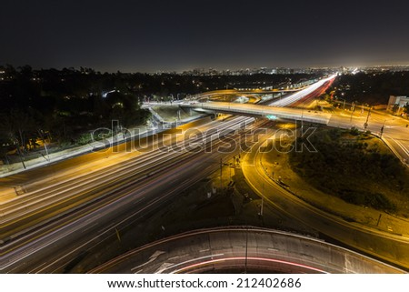 Sunset Blvd ramps and the San Diego 405 freeway at night in Los Angeles, California. - stock photo