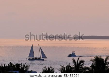 sunset boaters off key west florida - stock photo