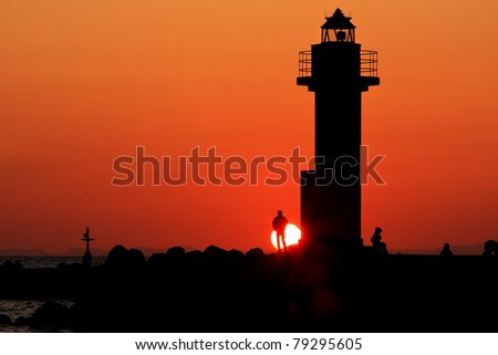 Sunset by the Lighthouse - stock photo