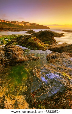 Sunset by the ocean in Newquay, UK - stock photo