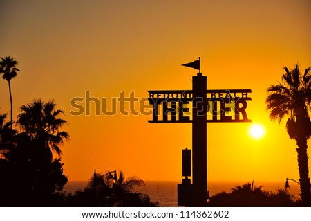 sunset by the pier - stock photo