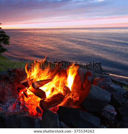 Sunset camp fire along the beautiful beach of Lake Superior in northern Michigan