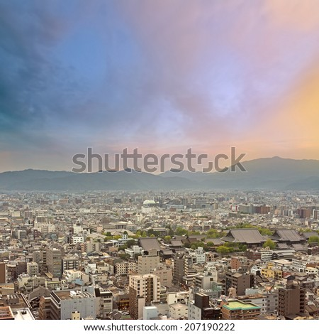 Sunset city scenery with buildings under dramatic sky, Kyoto, Japan, Asia. - stock photo