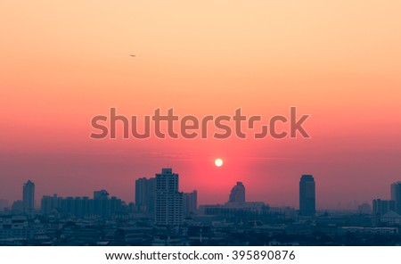 Sunset city scenery with sun and building in Bangkok; Thailand - stock photo