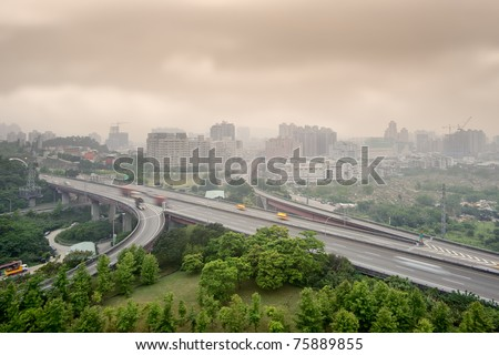 Sunset cityscape of highway and buildings with bad weather and air pollution, city scenery in Taipei, Taiwan. - stock photo