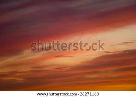 Sunset cloud background. Color transitions from yellow to deep purple. - stock photo