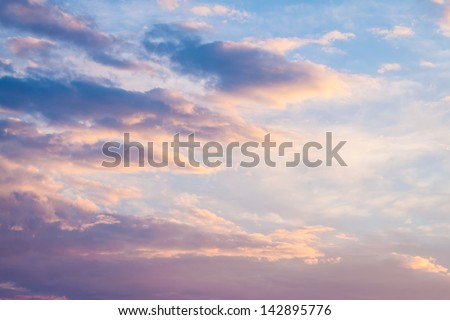 Sunset clouds vanilla color. - stock photo