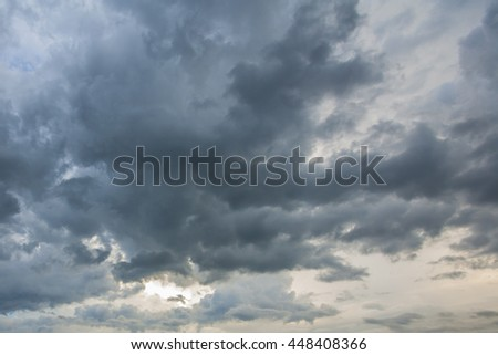 sunset clouds with sun setting down - stock photo