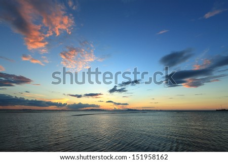 Sunset colorful sky,sea and cloudiness - stock photo