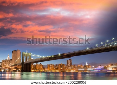 Sunset colors over Brooklyn Bridge with copyspace