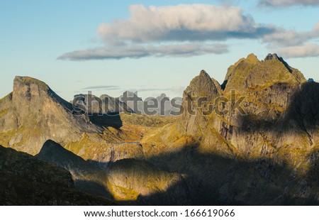 Sunset evening close view on sharp mountain ridge of Lofoten islands, Norway - stock photo