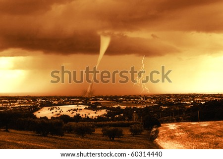sunset fire with hurricane on the city - stock photo