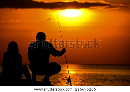 Sunset fishing on a beach