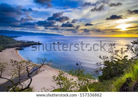 Sunset from above Waimea Bay on Oahu, Hawaii's North Shore - stock photo