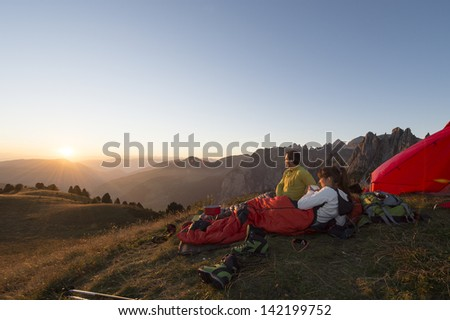 Sunset from the camping tent - Overnight in camping tent - Trekking in the Dolomite - stock photo