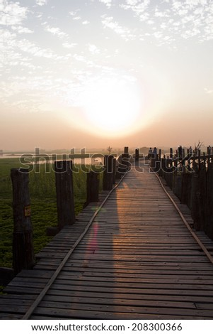 Sunset from the U-Bein bridge in Amarapura, in the Mandalay region of  Myanmar