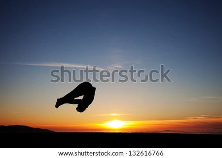 sunset gymnast - stock photo
