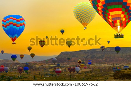 Sunset Hot air balloons landing in a mountain Cappadocia Goreme National Park Turkey tourist attraction