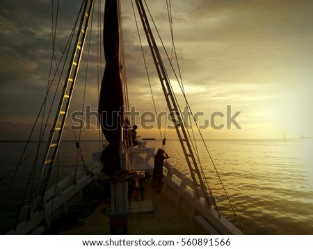 Sunset hunting with traditional Phinisi boat in Makassar, South Sulawesi, Indonesia, Asia