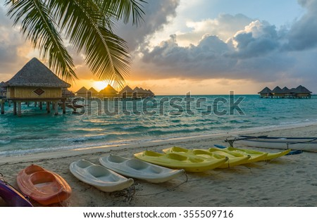 Sunset in a beach in Bora Bora, Tahiti - stock photo