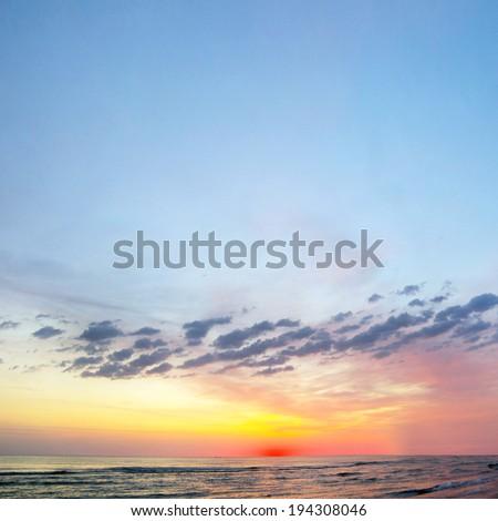 Sunset in Baltic sea - stock photo