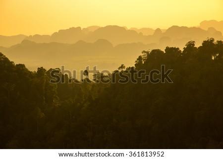 Sunset in beautiful mountains, Krabi province, Thailand  - stock photo