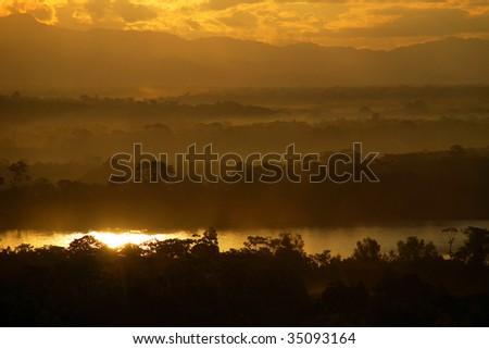 sunset in brazil rainforest - stock photo