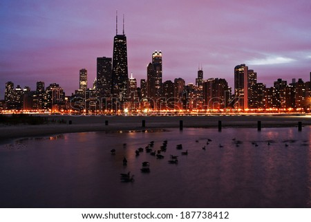 Sunset in Chicago with geese on Lake Michigan - stock photo