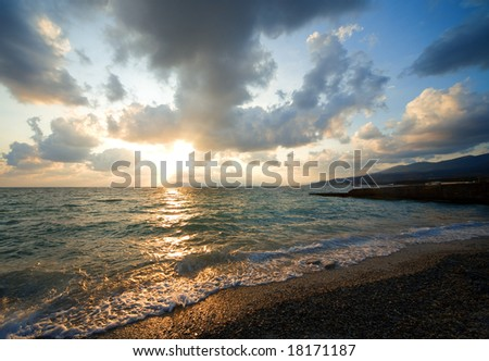 sunset in clouds above sea