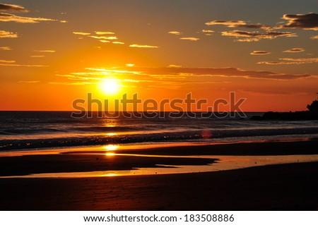 Sunset in El Salvador, playa El Sunzal - stock photo