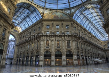 Sunset in famous luxury shopping mall Galleria Vittorio Emanuele in Milan, Italy - stock photo