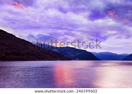 Sunset in fjord Hardanger Norway - nature and travel background - stock photo