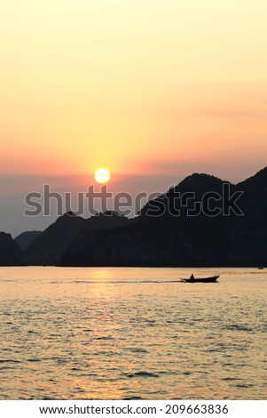 Sunset in Ha Long Bay - stock photo