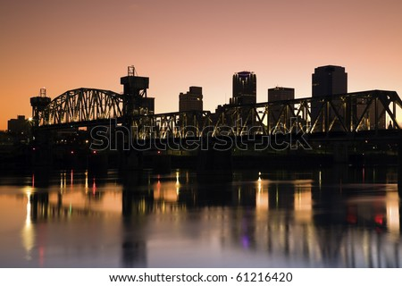 Sunset in Little Rock, Arkansas. Blurred barque in the foreground. - stock photo