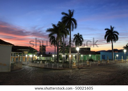 sunset in main square in trinidad, cuba - stock photo