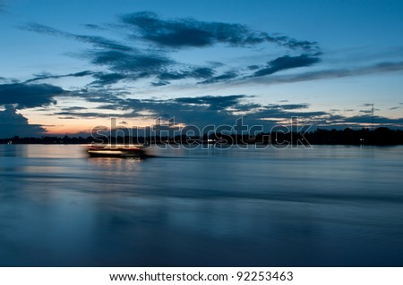 Sunset in mekong river - stock photo
