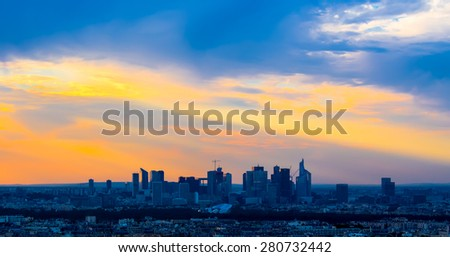 Sunset in Paris with beautiful sky. - stock photo
