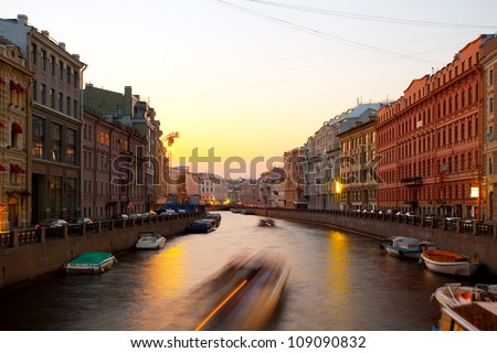 Sunset in the city on the river. (Fontanka River, St. Petersburg, Russia)