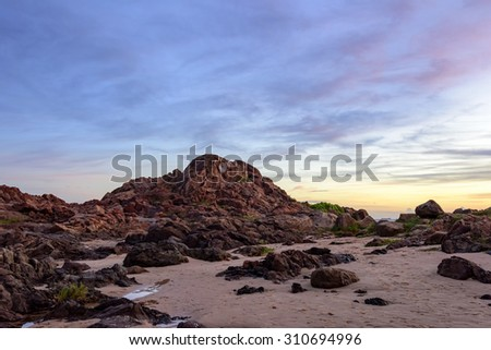 Sunset in the city Salvador in Bahia seen from the beach next to the old Lighthouse at Barra - stock photo