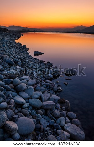 Sunset in the clear waters of Swat - stock photo