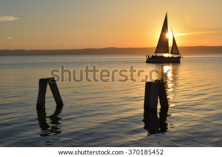 Sunset in the harbor at Neusiedler See. Lake and boats. - stock photo