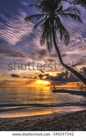 Sunset in the Maldives - stock photo