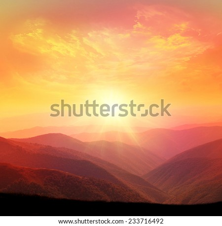 Sunset in the mountain - stock photo