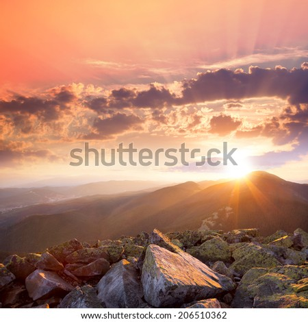 Sunset in the mountains landscape. Dramatic sky,  colorful stones and sunbeams. Carpathians, Ukraine, Europe - stock photo