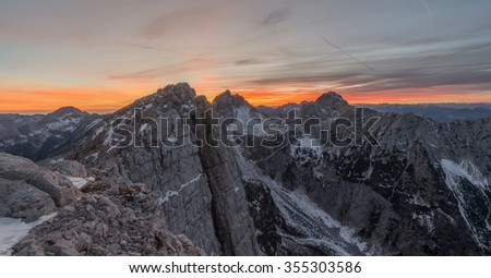 Sunset in the mountains with hikers resting at the top